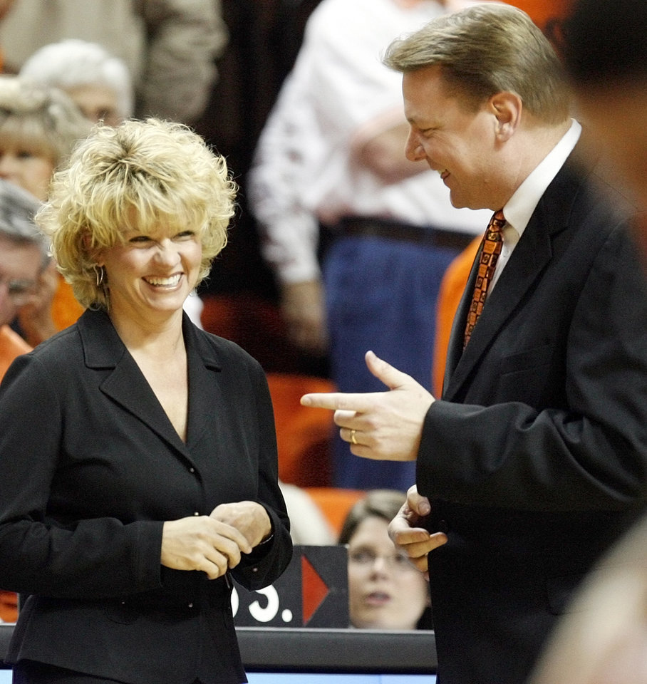 Photo - OU head coach Sherri Coale, left, and OSU head coach Kurt Budke talk before the women's college basketball game between the Oklahoma State University Cowgirls and the University of Oklahoma Sooners at Gallagher-Iba Arena in Stillwater, Okla., Wednesday, Jan. 17, 2007. OU won, 76-60. By Nate Billings, The Oklahoman