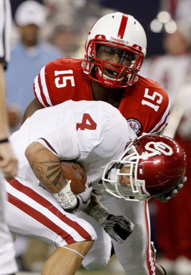Photo - OU's Kenny Stills fights for more yards against Nebraska's Alfonzo Dennard during the Big 12 football championship game between the University of Oklahoma Sooners (OU) and the University of Nebraska Cornhuskers (NU) at Cowboys Stadium on Saturday, Dec. 4, 2010, in Arlington, Texas.  Photo by Bryan Terry, The Oklahoman