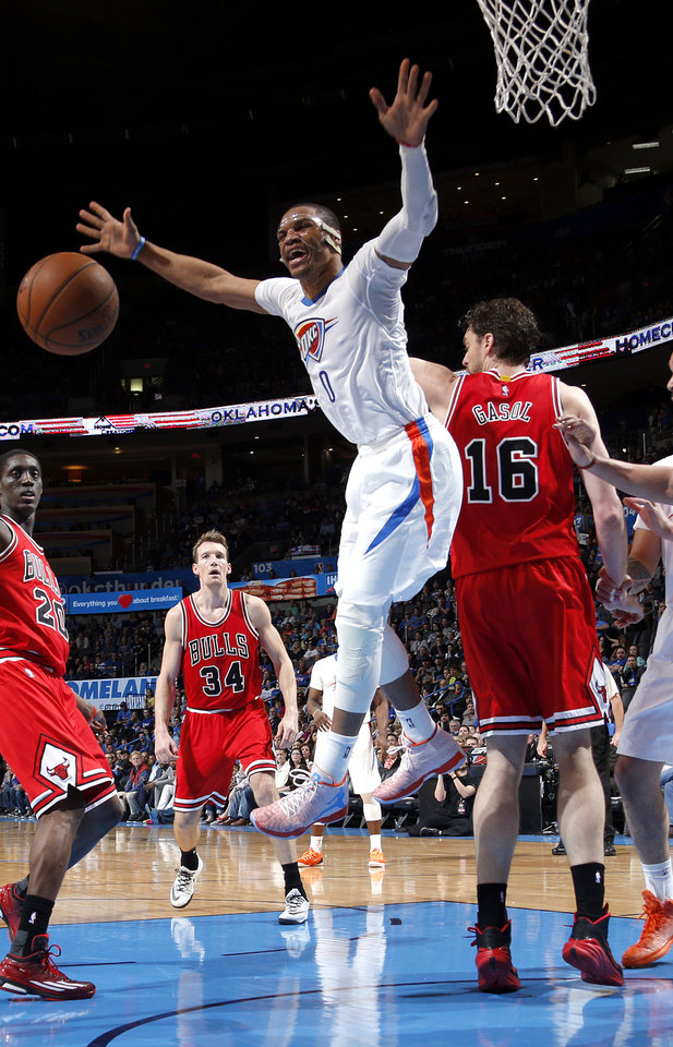 Photo - Oklahoma City's Russell Westbrook (0) reacts to foul in front of Chicago's Pau Gasol (16) during the NBA game between the Oklahoma City Thunder and the Chicago Bulls at Chesapeake Energy Arena in Oklahoma City, Sunday, March  15, 2015. Photo by Sarah Phipps, The Oklahoman