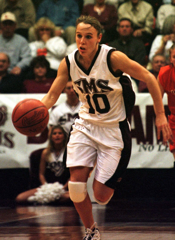 Photo - Southwest Missouri State's Jackie Stiles brings the ball down court during a game with Oklahoma State Wednesday, Nov. 29, 2000 in Springfield, Mo. Stiles was hired Wednesday as as assistant coach at Oklahoma. (AP Photo/John S. Stewart)