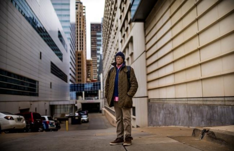 Photo - Michael Taylor, 58, poses for a photo in downtown Oklahoma City, Okla. on Friday, Dec. 20, 2019. Taylor, who is homeless, was released through commutation from the Oklahoma State Penitentiary in November.      [Chris Landsberger/The Oklahoman]