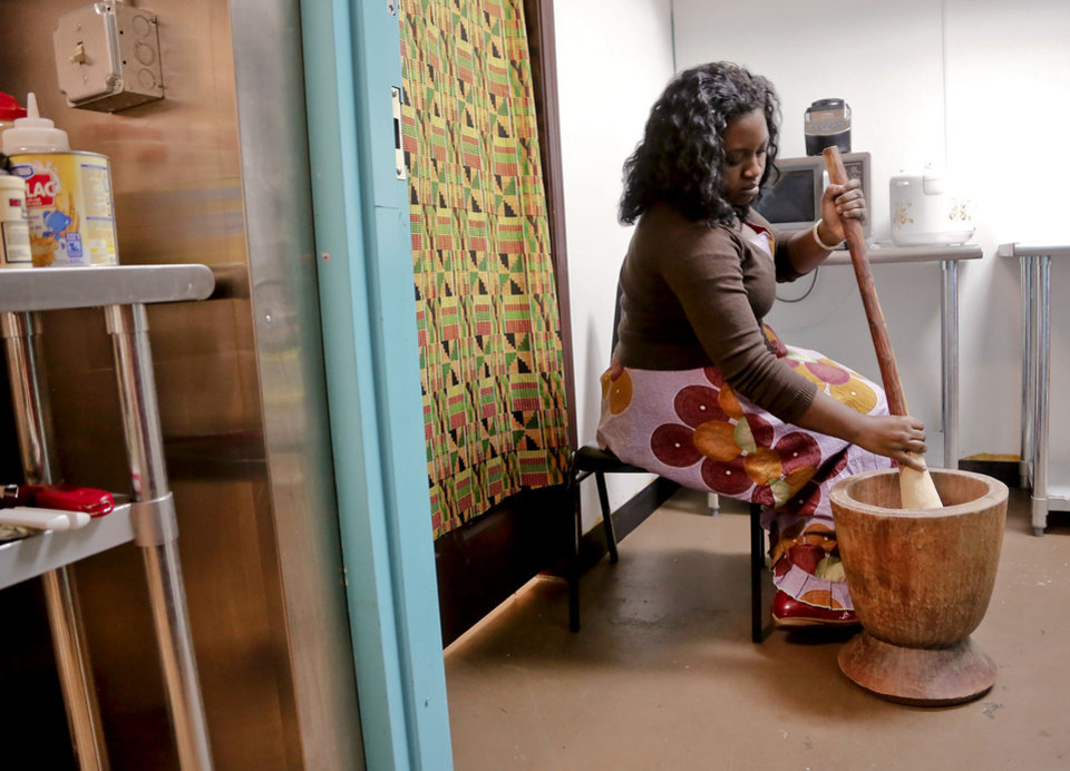 Photo - Ijeoma Popoola, Mama Sinmi, prepares fufu for her restaurant in Oklahoma City. Photo by Chris Landsberger, The Oklahoman  CHRIS LANDSBERGER - CHRIS LANDSBERGER