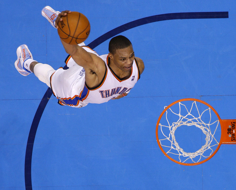 Photo - Oklahoma City's Russell Westbrook (0) attempts a dunk during Game 3 of the Western Conference Finals in the NBA playoffs between the Oklahoma City Thunder and the San Antonio Spurs at Chesapeake Energy Arena in Oklahoma City, Sunday, May 25, 2014. Photo by Bryan Terry, The Oklahoman