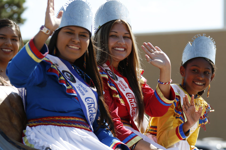 Photo -  ABOVE: The Chickasaw Nation Royalty participates in Saturday's 2019 Red Earth Festival parade.