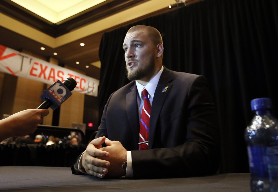 Photo - Kansas offensive lineman Jordan Shelley-Smith responds to questions during Big 12 Conference Football Media Days Monday, July 20, 2015, in Dallas. (AP Photo/Tony Gutierrez)