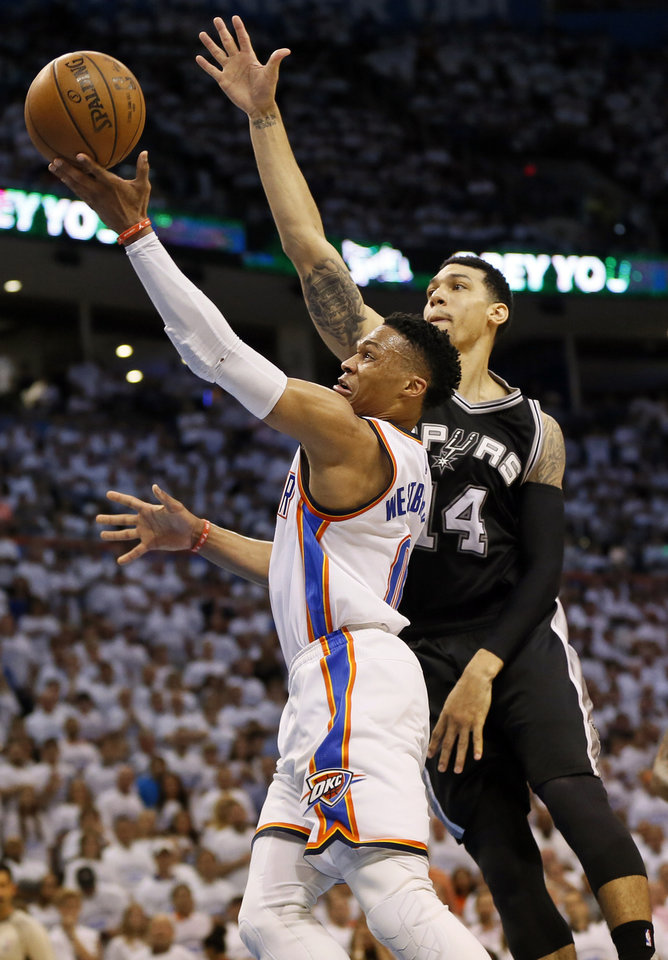 Photo - Oklahoma City's Russell Westbrook (0) shoots in front of San Antonio's Danny Green (14) during Game 4 of the Western Conference semifinals between the Oklahoma City Thunder and the San Antonio Spurs in the NBA playoffs at Chesapeake Energy Arena in Oklahoma City, Sunday, May 8, 2016. Oklahoma City won 111-97. Photo by Nate Billings, The Oklahoman