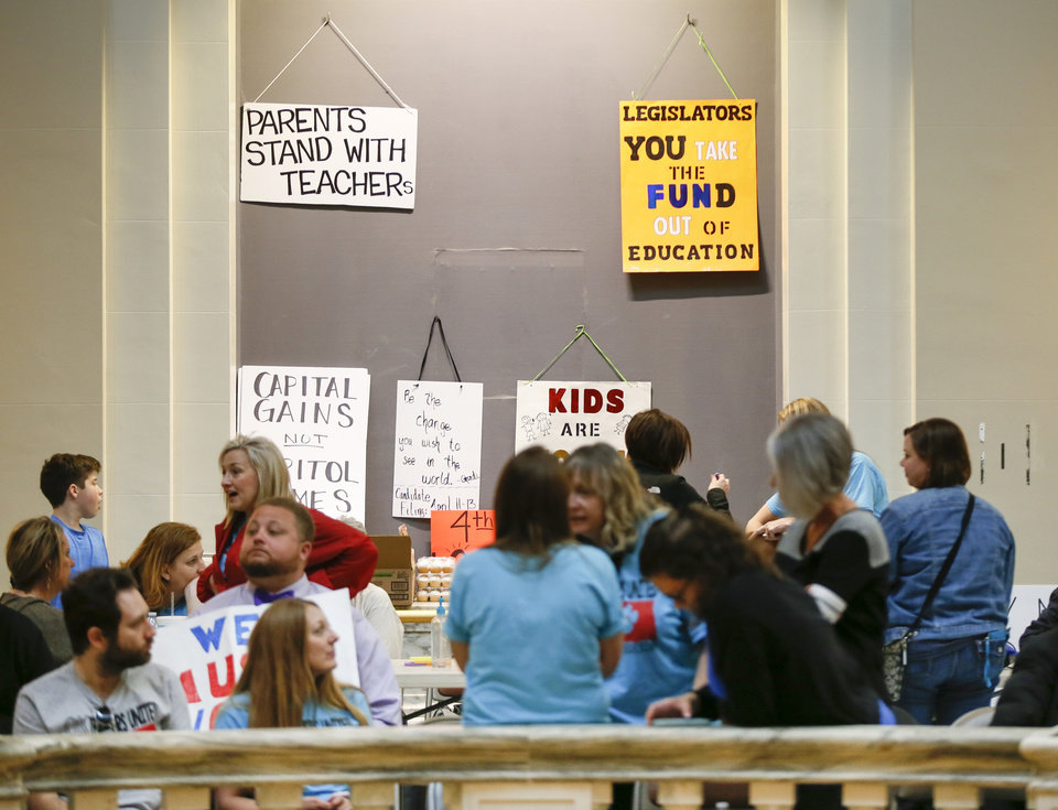 Photo -  Signs hang in a space that usually displays a painting in the fourth-floor rotunda at the state Capitol during the 10th day of a walkout by Oklahoma teachers in Oklahoma City. [Photo by Nate Billings, The Oklahoman]