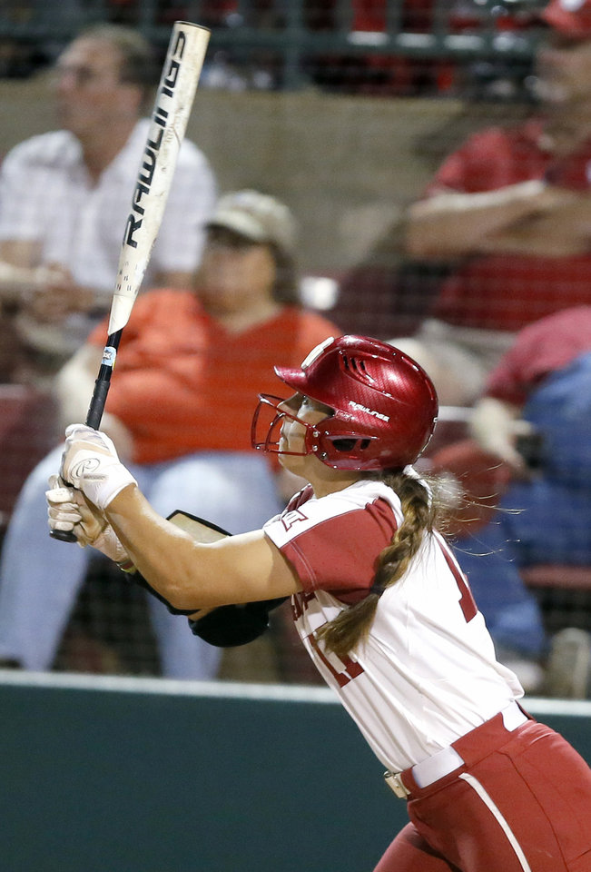 Photo - Oklahoma's Nicole Mendes (11) hits a two-run home run in the third inning of the Norman Regional NCAA softball tournament game between the University of Oklahoma (OU) and UMBC in Norman, Okla., Friday, May 17, 2019. Oklahoma won 12-0.  [Bryan Terry/The Oklahoman]