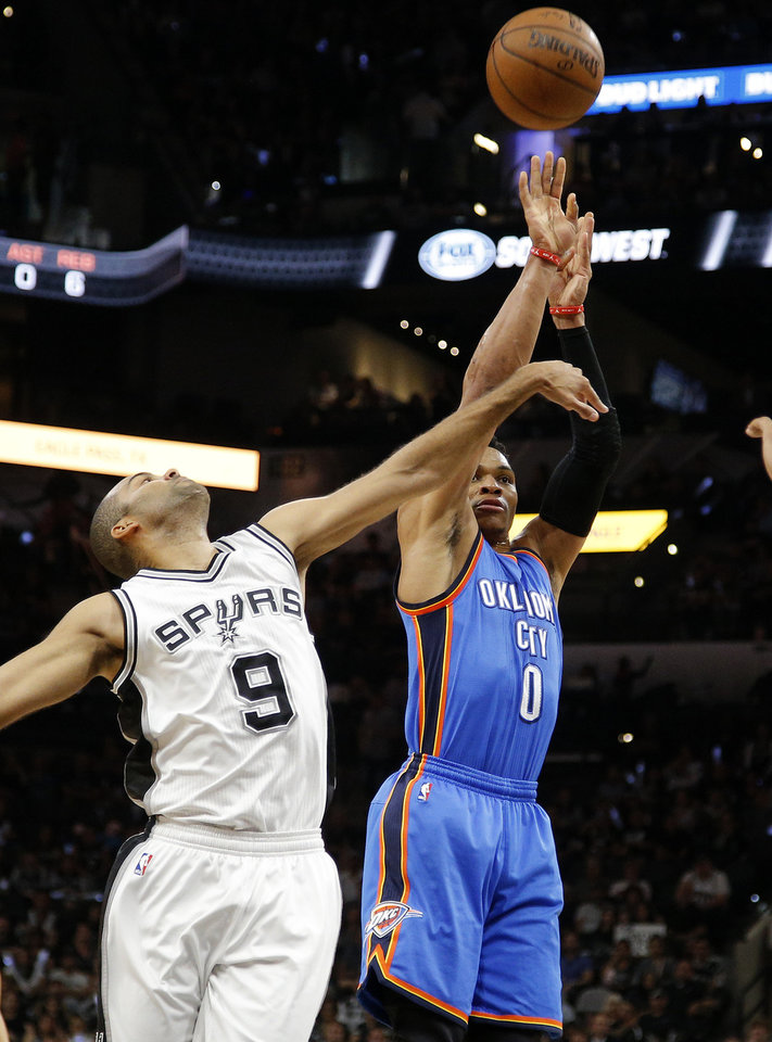 Photo - Oklahoma City's Russell Westbrook (0) shoots from beside San Antonio's Tony Parker (9) during Game 5 of the second-round series between the Oklahoma City Thunder and the San Antonio Spurs in the NBA playoffs at the AT&T Center in San Antonio, Tuesday, May 10, 2016. Oklahoma City won 95-91. Photo by Bryan Terry, The Oklahoman