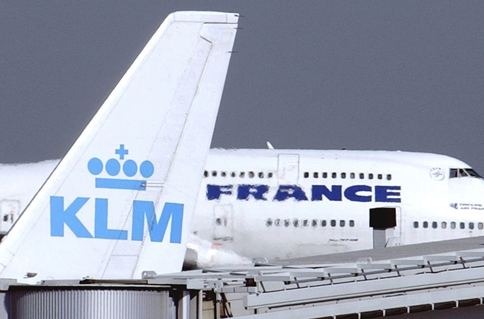 Photo -  FILE - In this Sept. 30, 2003 file photo, an Air France jumbo jet rolls behind the tail of a KLM Royal Dutch airliner at Charles de Gaulle airport in Roissy, north of Paris. Air France-KLM plunged to a 7.1 billion euro ($8.5 billion) loss in 2020 as the global pandemic grounded planes and halted travel plans worldwide causing a 67% slump in passenger numbers at the French-Dutch aviation giant. (AP Photo/Remy de la Mauviniere, File)