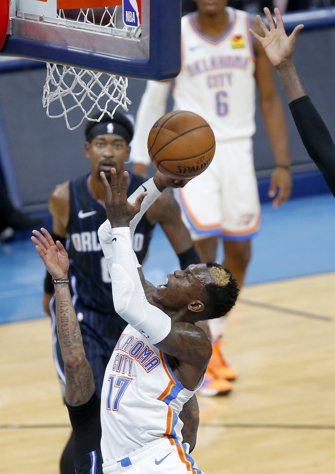 Photo - Oklahoma City's Dennis Schroder (17) goes to the basket during an NBA basketball game between the Oklahoma City Thunder and the Orlando Magic at Chesapeake Energy Arena in Oklahoma City, Tuesday, Nov. 5, 2019. Oklahoma City won 102-94. [Bryan Terry/The Oklahoman]
