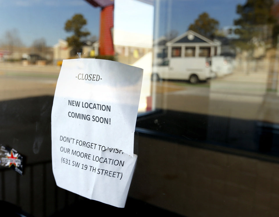 Photo -  A sign in the window of a former Schlotzsky's restaurant in Norman indicates the business is relocating.