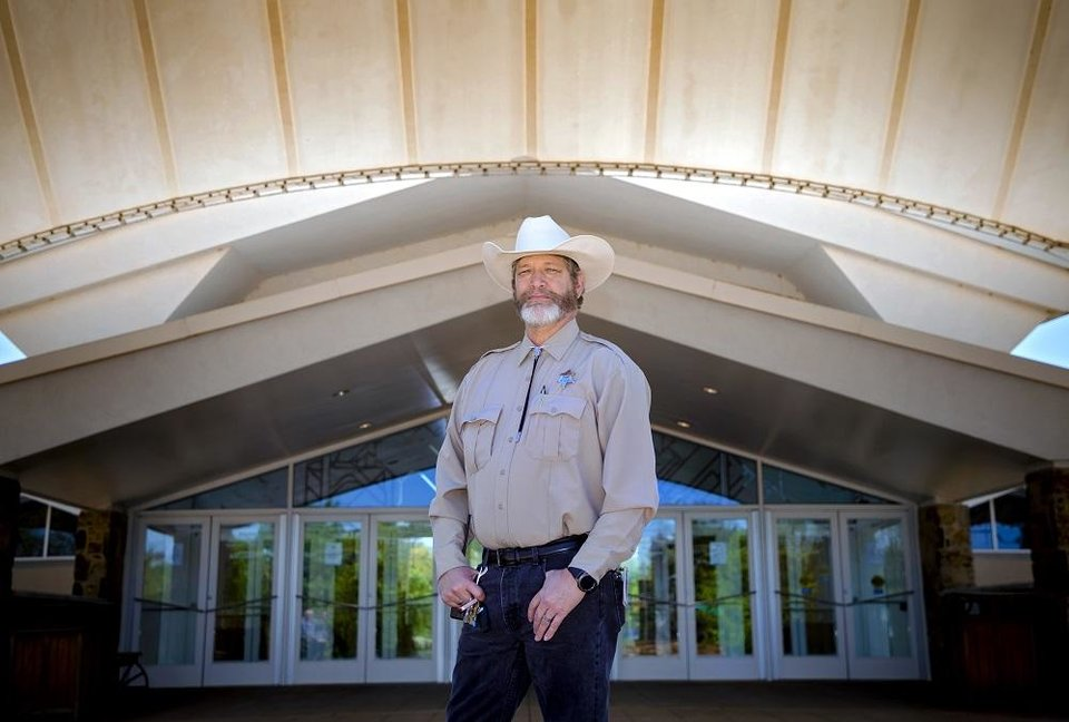 Photo - Tim Tiller, National Cowboy & Western Heritage Museum's head of security, poses for a photo outside the museum in Oklahoma City, Okla. on Wednesday, April 15, 2020. Tiller's takeover of the museum's social media during its spring closure due to the coronavirus earned him global social media attention. [Chris Landsberger/The Oklahoman Archives]