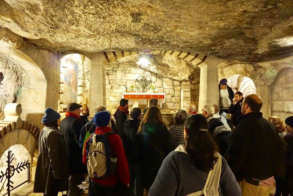 Photo -  The Oklahoma Religions United tour group visits a shrine at the Church of the Nativity in Bethlehem. [Photo by Evan Taylor]