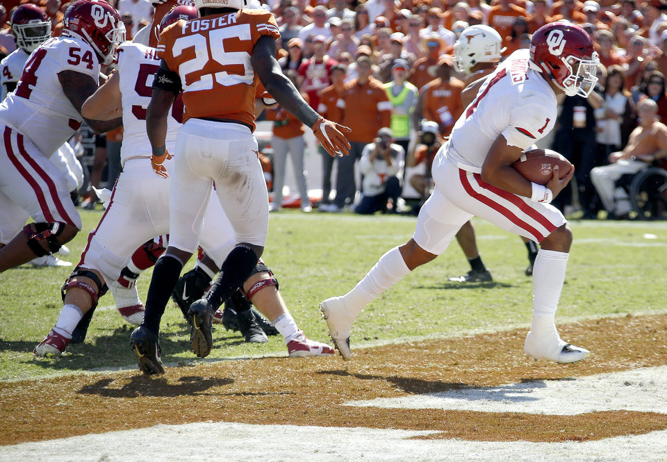 Photo - Oklahoma's Jalen Hurts (1) scores a touchdown in the fourth quarter during the Red River Showdown college football game between the University of Oklahoma Sooners (OU) and the Texas Longhorns (UT) at Cotton Bowl Stadium in Dallas, Saturday, Oct. 12, 2019. OU won 34-27. [Sarah Phipps/The Oklahoman]