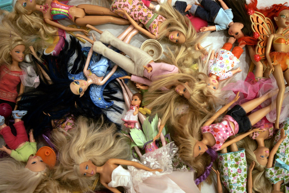Photo - Barbie dolls are seen at the Barbie Store in Buenos Aires in 2007. (AP Photo/Natacha Pisarenko, file)  Natacha Pisarenko - AP