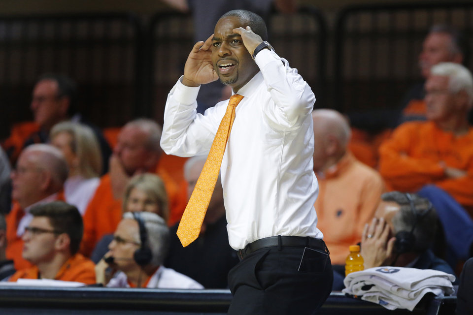 Photo - Oklahoma State coach Mike Boynton looks toward an official during an NCAA basketball game between the Oklahoma State University Cowboys (OSU) and the Texas Longhorns at Gallagher-Iba Arena in Stillwater, Okla., Wednesday, Jan. 15, 2020. Oklahoma State lost 76-64. [Bryan Terry/The Oklahoman]