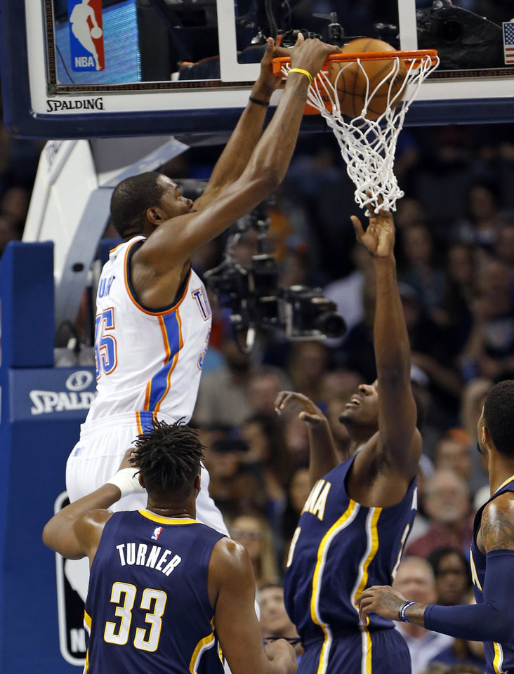 Photo - Oklahoma City Thunder's Kevin Durant (35) scores on a dunk in the first half of an NBA basketball game where the Oklahoma City Thunder play the Indiana Pacers at the Chesapeake Energy Arena in Oklahoma City, on Feb. 19, 2016.  Photo by Steve Sisney The Oklahoman