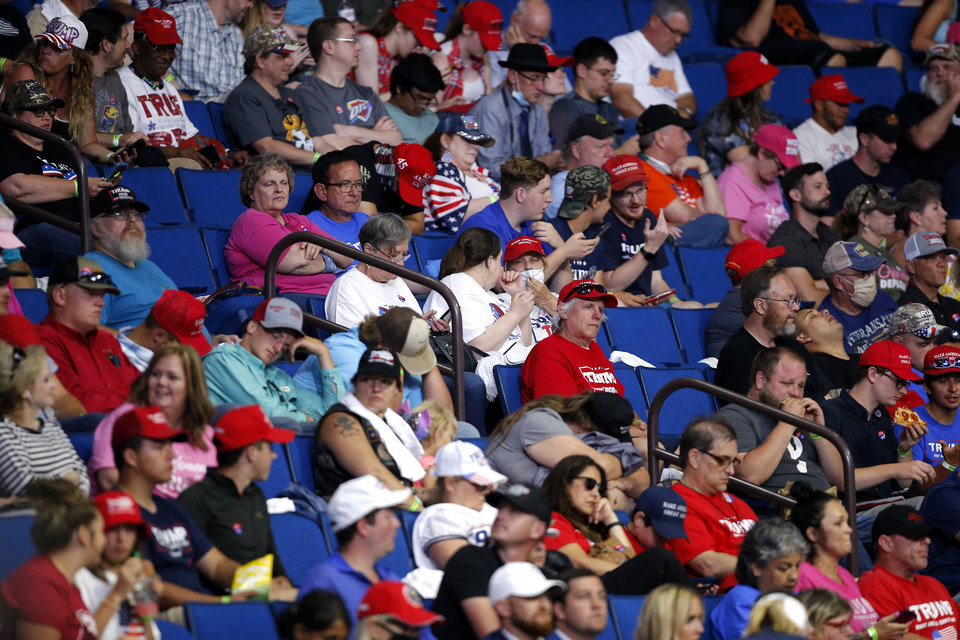 Photo - People wait for the arrival of President Donald Trump during a rally at the BOK in Tulsa, Okla., Saturday, June 20, 2020. [Sarah Phipps/The Oklahoman]