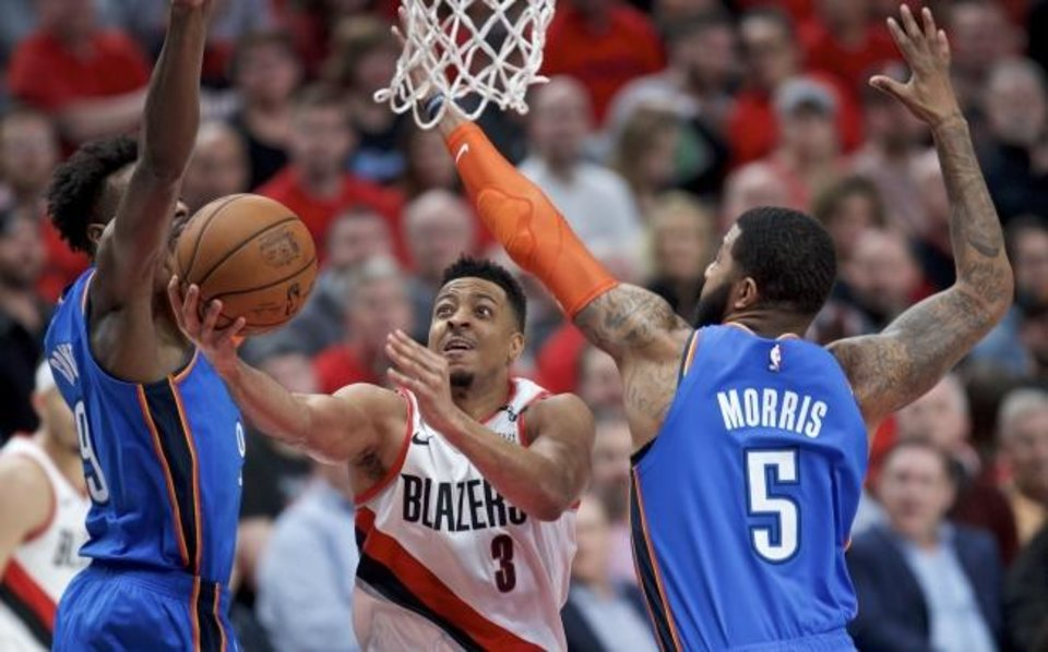 Photo -  Trail Blazers guard CJ McCollum, center, is averaging 28.5 points per game in the playoffs against the Thunder and is making 42.9 percent of his 3-pointers. [AP Photo/Craig Mitchelldyer]