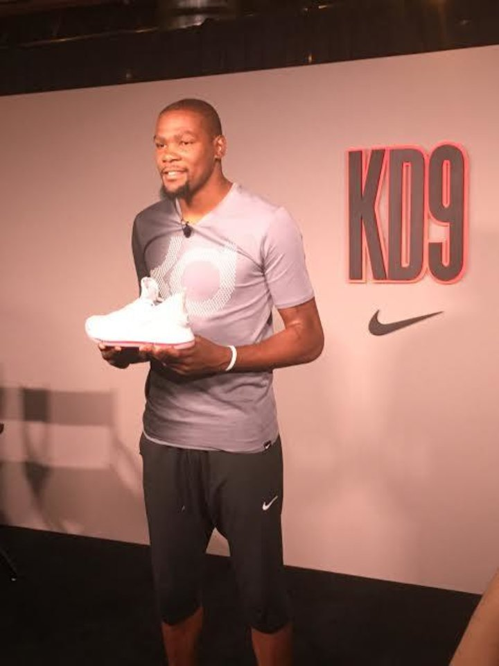 Photo - Oklahoma City Thunder star Kevin Durant shows off his new KD9 sneaker during an event Monday in Austin, Texas. Durant talked about the new shoe, the Olympics and his upcoming free agency. (Photo by Anthony Slater, The Oklahoman)