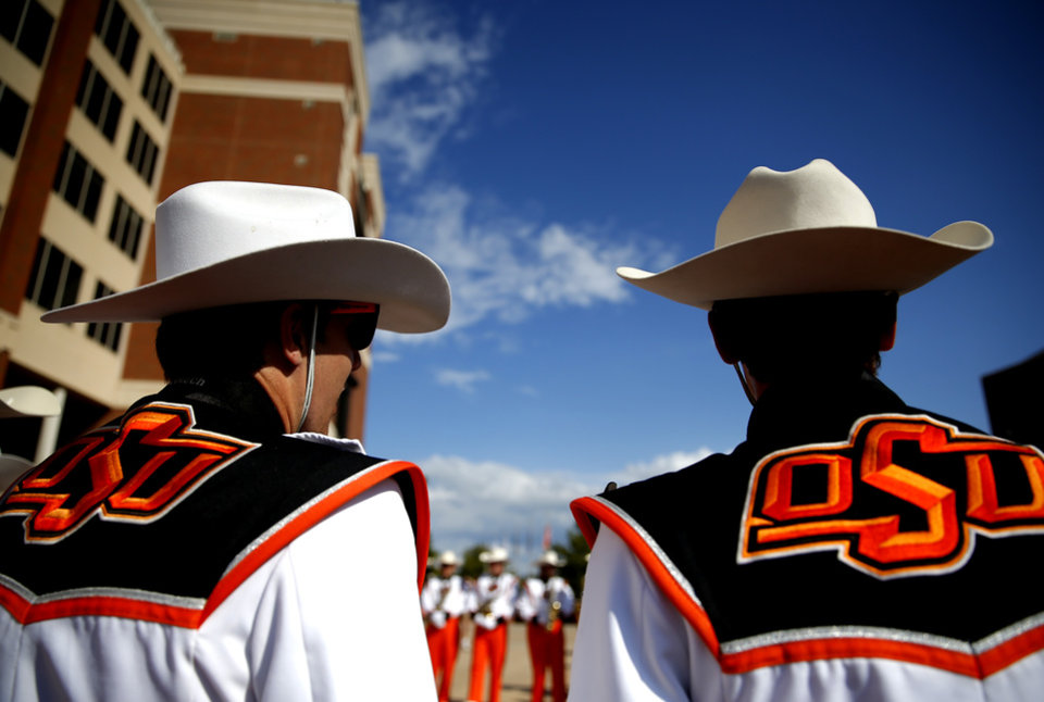 Photo - The Oklahoma State marching band waits to play during the walk before the college football game between the Oklahoma State Cowboys and the Kansas State Wildcats at Boone Pickens Stadium in Stillwater, Okla., Saturday, Sept. 28, 2019. [Sarah Phipps/The Oklahoman]