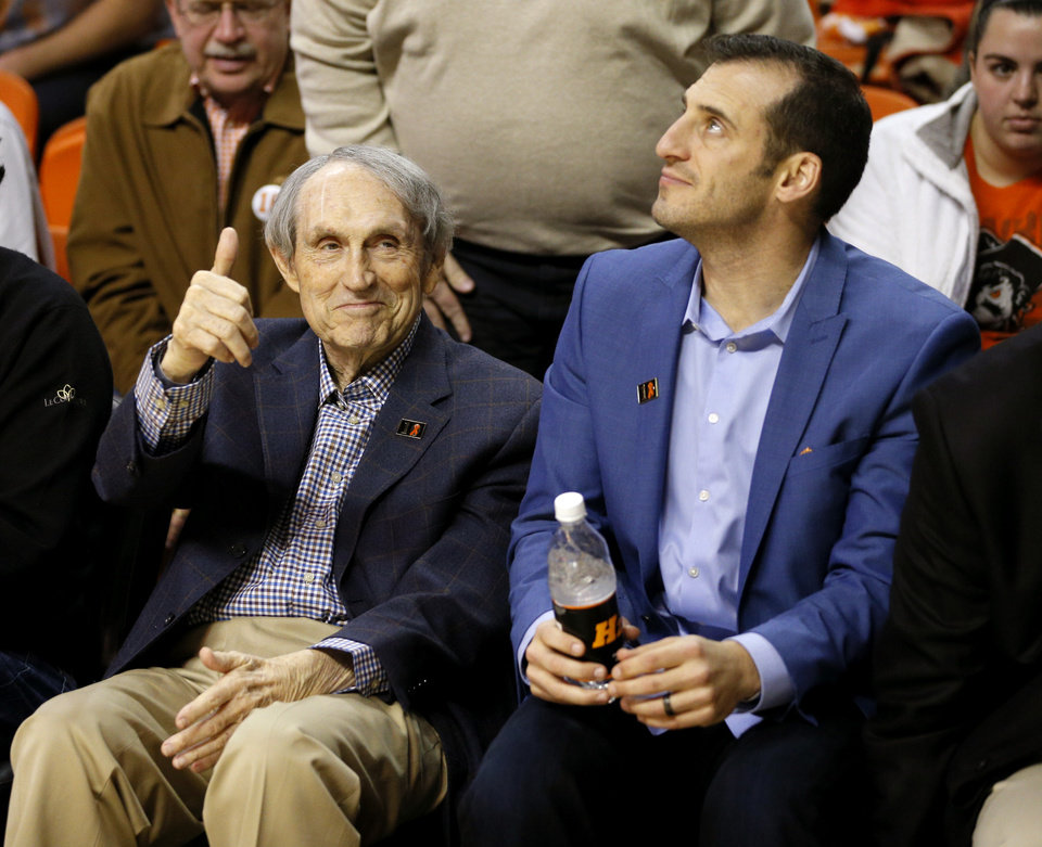 Photo - Eddie Sutton is recognized by the crowd as Doug Gottlieb sits beside him during an NCAA college basketball game between the Oklahoma State University Cowboys (OSU) and Baylor at Gallagher-Iba Arena in Stillwater, Okla., Wednesday, Jan. 27, 2016. Oklahoma State lost 69-65. Photo by Bryan Terry, The Oklahoman