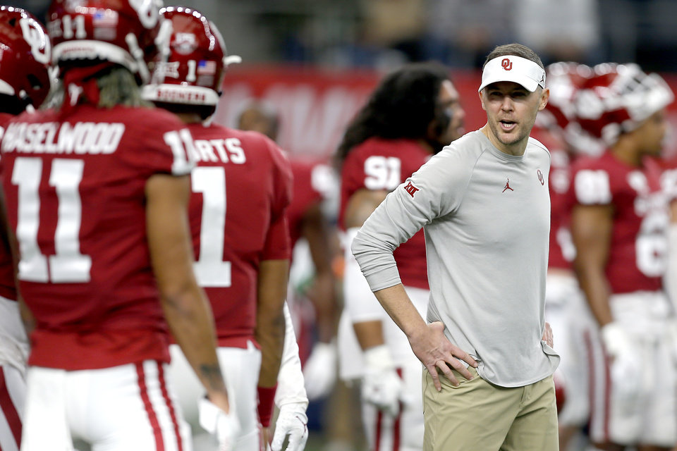 Photo - Oklahoma coach Lincoln Riley talks with players before the Big 12 Championship Game between the University of Oklahoma Sooners (OU) and the Baylor University Bears at AT&T Stadium in Arlington, Texas, Saturday, Dec. 7, 2019. [Bryan Terry/The Oklahoman]