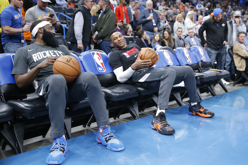 Photo - Houston's Russell Westbrook, right, and James Harden sit on the bench before an NBA basketball game between the Oklahoma City Thunder and Houston Rockets at Chesapeake Energy Arena in Oklahoma City, Thursday, Jan. 9, 2020. [Sarah Phipps/The Oklahoman]