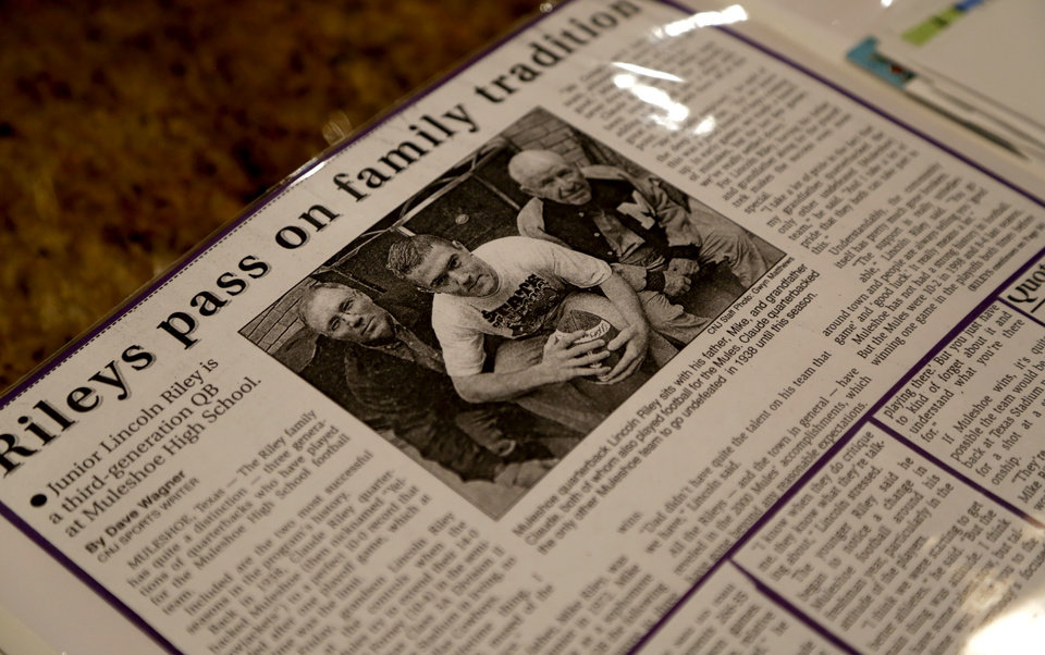 Photo - A newspaper article from the Clovis News Journal about Oklahoma's offensive coordinator Lincoln Riley in high school is seen at his parent's home in Muleshoe, Texas, on Thursday, June 25, 2015. Photo by Bryan Terry, The Oklahoman