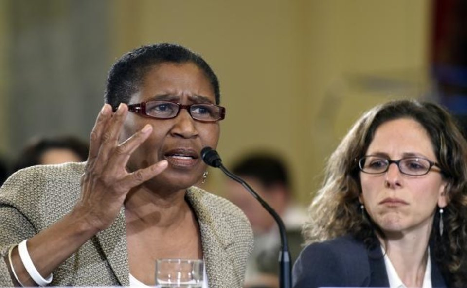 Photo -  National Basketball Players Association executive director Michele Roberts, left, says she can't think of a day since mid-March when she and Paul, president of the NBPA, didn't talk. [AP Photo/Susan Walsh]