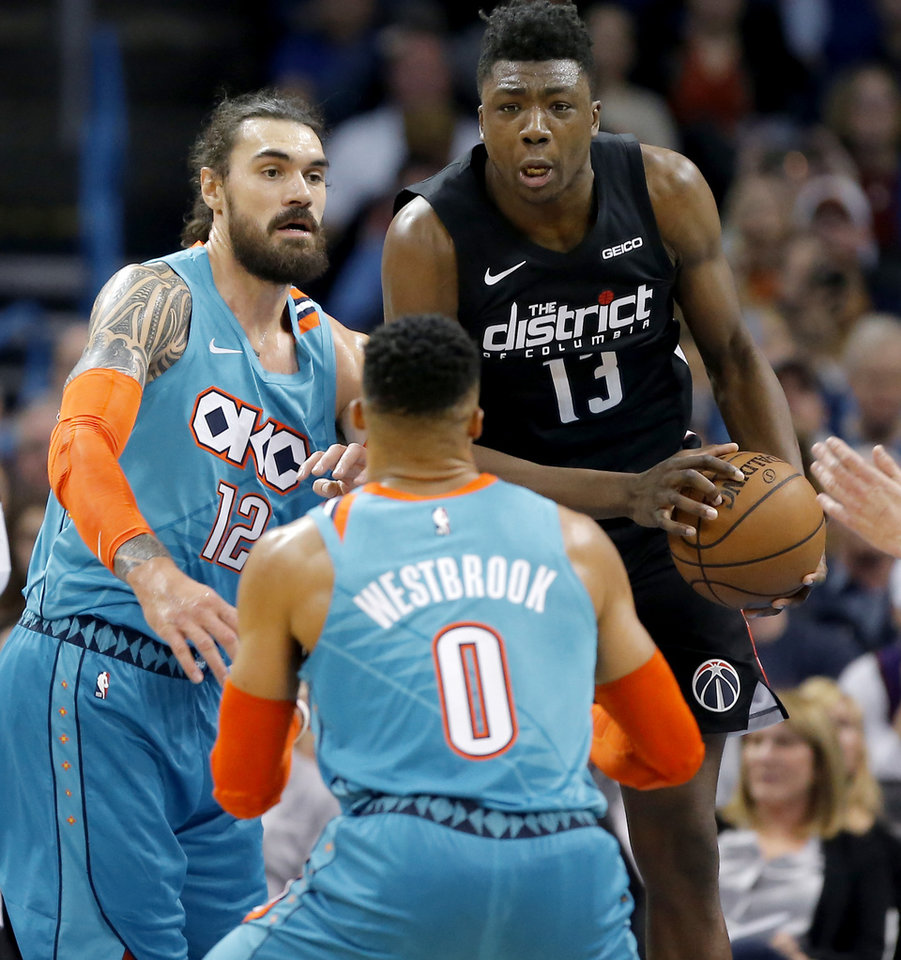 Photo - Washington's Thomas Bryant (13) grabs a rebound beside Oklahoma City's Steven Adams (12) during an NBA basketball game between the Oklahoma City Thunder and the Washington Wizards at Chesapeake Energy Arena in Oklahoma City, Sunday, Jan. 6, 2019. Photo by Bryan Terry, The Oklahoman