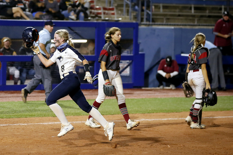 Photo - Southmoore's Riley Sharp celebrates as she runs toward her team after driving in the game-winning run during the Class 6A state softball championship game between Southmoore and Owasso at USA Softball Hall of Fame Stadium in Oklahoma City, Saturday, Oct. 17, 2020. [Bryan Terry/The Oklahoman]