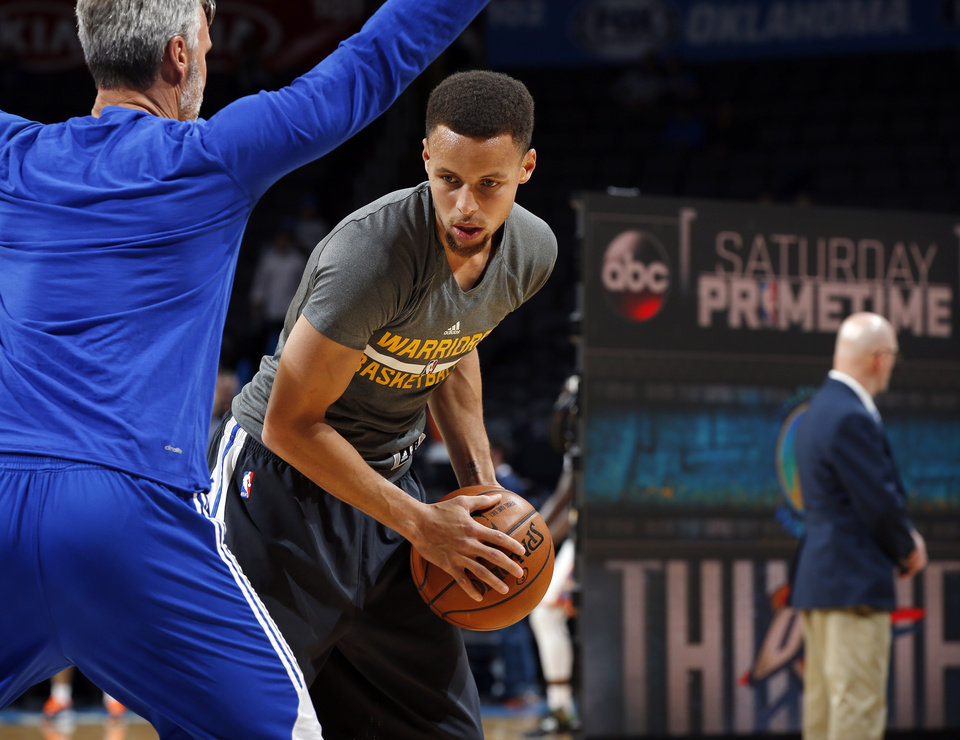 Photo - Golden State's Stephen Curry (30) warms up before an NBA basketball game between the Oklahoma City Thunder and the Golden State Warriors at Chesapeake Energy Arena in Oklahoma City, Saturday, Feb. 27, 2016. Photo by Nate Billings, The Oklahoman