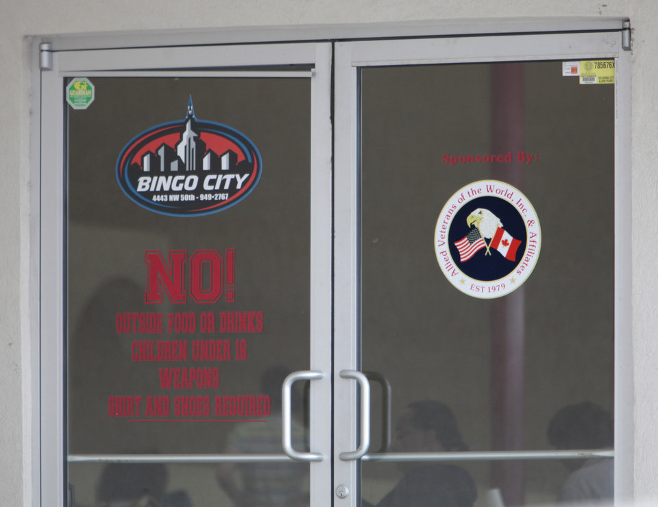 Photo - Bingo City has a symbol for Allied Veterans of the World on its door. Authorities in Florida allege the group has become a front for illegal gambling activiites in that state. Photo by David McDaniel, The Oklahoman