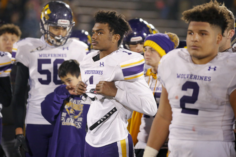 Photo - Vian's Javyn Wright stands with teammates after the Class 2A football state championship game between Tulsa Metro Christian and Vian at Wantland Stadium in Edmond, Okla., Saturday, Dec. 14, 2019. [Bryan Terry/The Oklahoman]