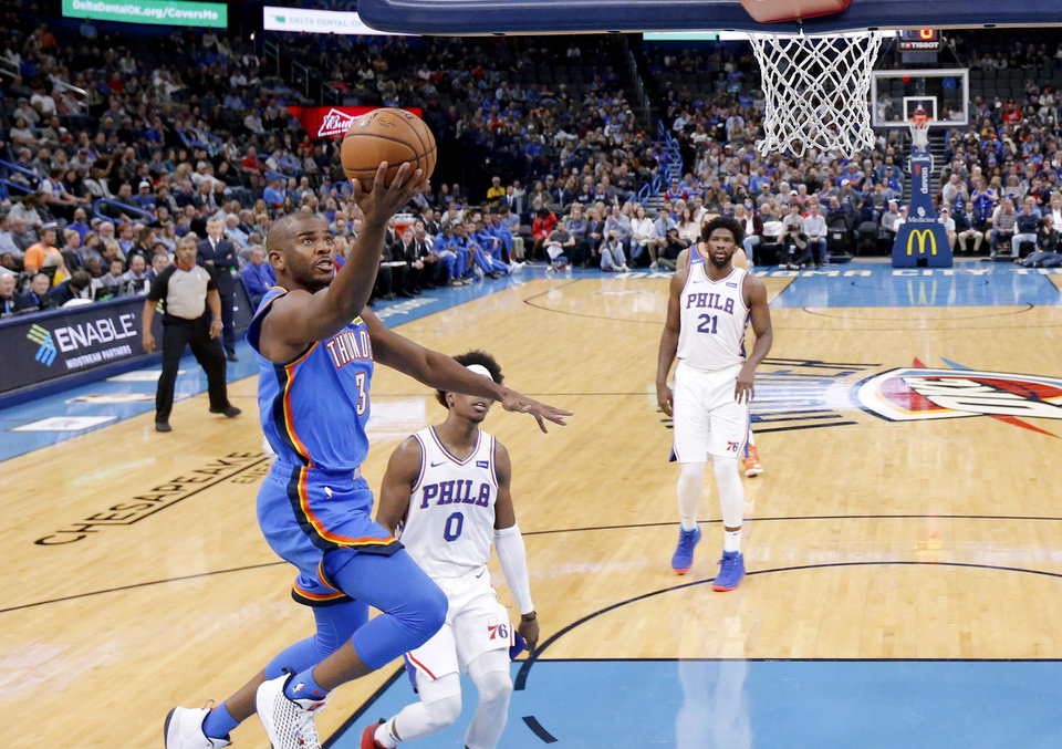 Photo - Oklahoma City's Chris Paul (3) goes to the basket during an NBA basketball game between the Oklahoma City Thunder and the Philadelphia 76ers at Chesapeake Arena in Oklahoma City, Friday, Nov. 15, 2019. Oklahoma City won 127-119. [Bryan Terry/The Oklahoman]