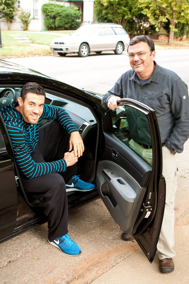 Photo - Oklahoma City Thunder player Nick Collison, left, sits in the Uber ride he got from Oklahoma City resident David Glover as the first passenger for Oklahoma City's newest transportation service. PHOTO PROVIDED.