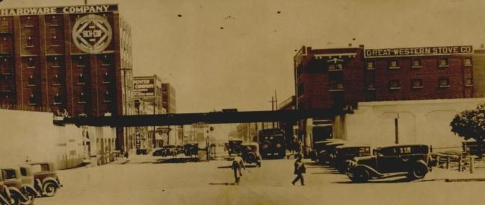 Photo -  This 1932 photograph looking east on Grand (Sheridan) shows progress contractors were making to elevate the Santa Fe tracks over downtown roads. [THE OKLAHOMAN ARCHIVES]