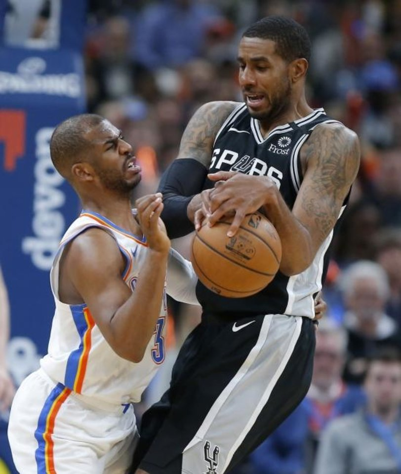 Photo -  Oklahoma City's Chris Paul, left, defends San Antonio's LaMarcus Aldridge during Tuesday night's game at Chesapeake Energy Arena. San Antonio beat the Thunder 114-106. [Bryan Terry/The Oklahoman]