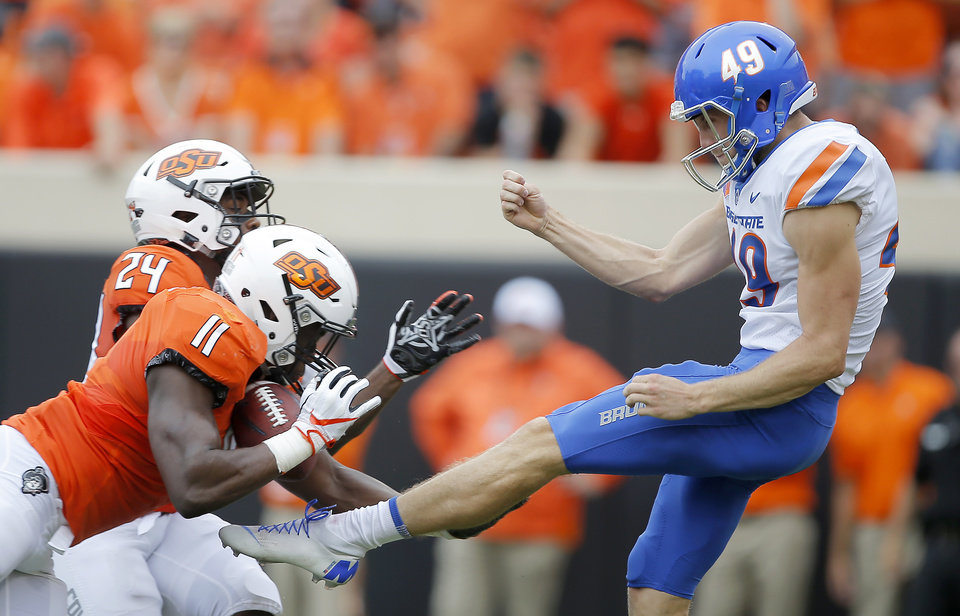 Photo - Oklahoma State's Amen Ogbongbemiga (11) blocks the punt of Boise State's Quinn Skillin (49) during a college football game between the Oklahoma State University Cowboys (OSU) and the Boise State Broncos at Boone Pickens Stadium in Stillwater, Okla., Saturday, Sept. 15, 2018. Photo by Bryan Terry, The Oklahoman