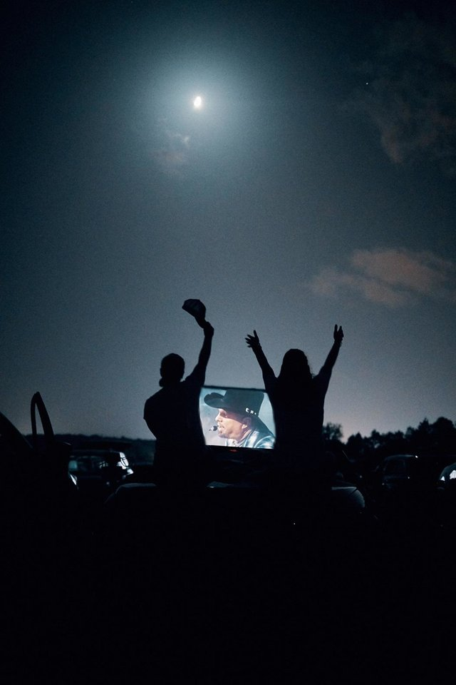 Photo - Fans attend Saturday's Garth Brooks drive-in concert. [Photo by 8 Ten Inc.]