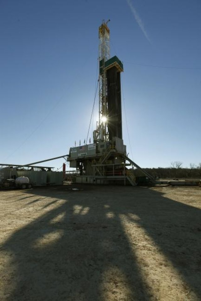 Photo -  A Cactus rig drills a well for Devon Energy in 2014. [OKLAHOMAN ARCHIVES]