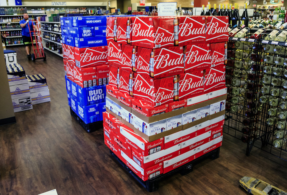 Photo - Work is being done to get the store stocked with high point beer at Midwest Wine & Spirits in Midwest City, Okla. on Wednesday, Sept. 26, 2018. Photo by Chris Landsberger, The Oklahoman