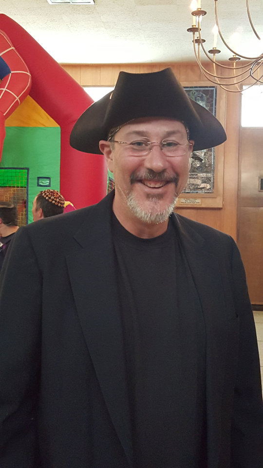 Photo - Jeff Goss, Emanuel Synagogue's director of youth education, dressed as Haman, the villain in the Purim story, during the synagogue's recent Purim festivities in Oklahoma City. [Photo by Carla Hinton, The Oklahoman]