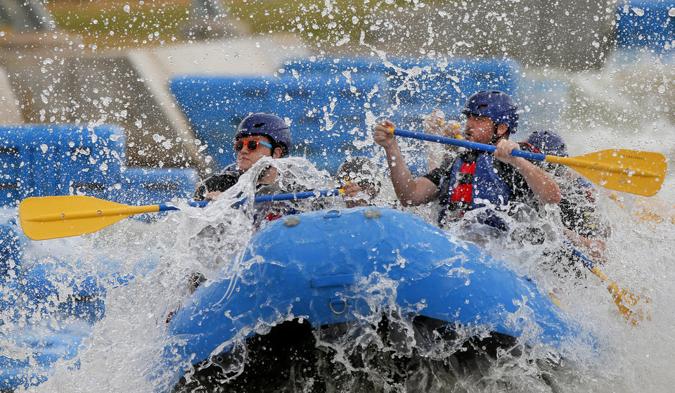 Photo - Rafters from Love's compete in the RIVERSPORT Whitewater Rafting League Championship during the Stars & Stripes River Festival in Oklahoma City, Saturday, June 24, 2017. Photo by Bryan Terry, The Oklahoman