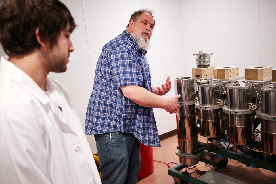 Photo -  Red Dirt Labs co-owner Tommy Gragg discusses the carbon dioxide extraction process with Lab Director Matthew Messuri, at Red Dirt Labs.