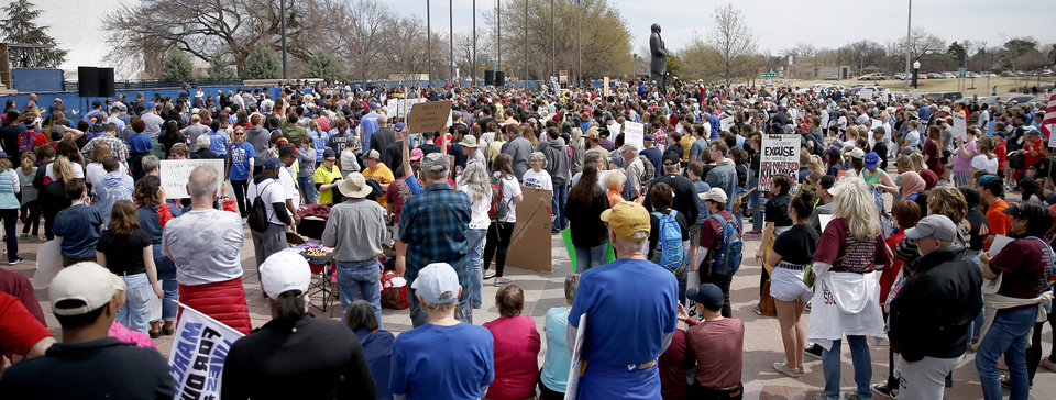 Photo -  People gather Saturday outside the state Capitol in Oklahoma City during a