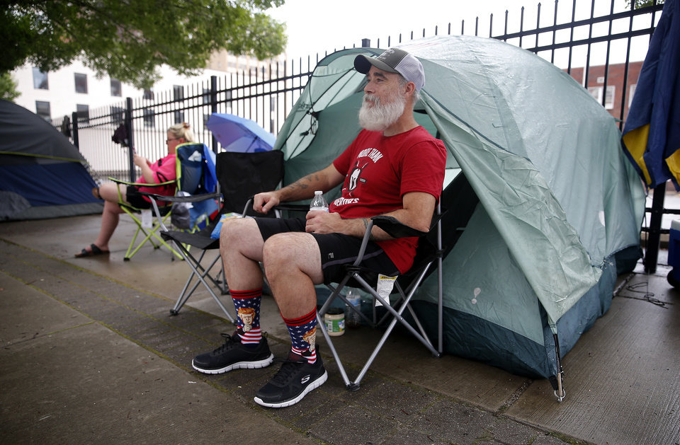 Photo - Ryan Witt sits at his campsite in downtown Tulsa, Okla., ahead of President Donald Trump's Saturday campaign rally, Friday, June 19, 2020. [Sarah Phipps/The Oklahoman]