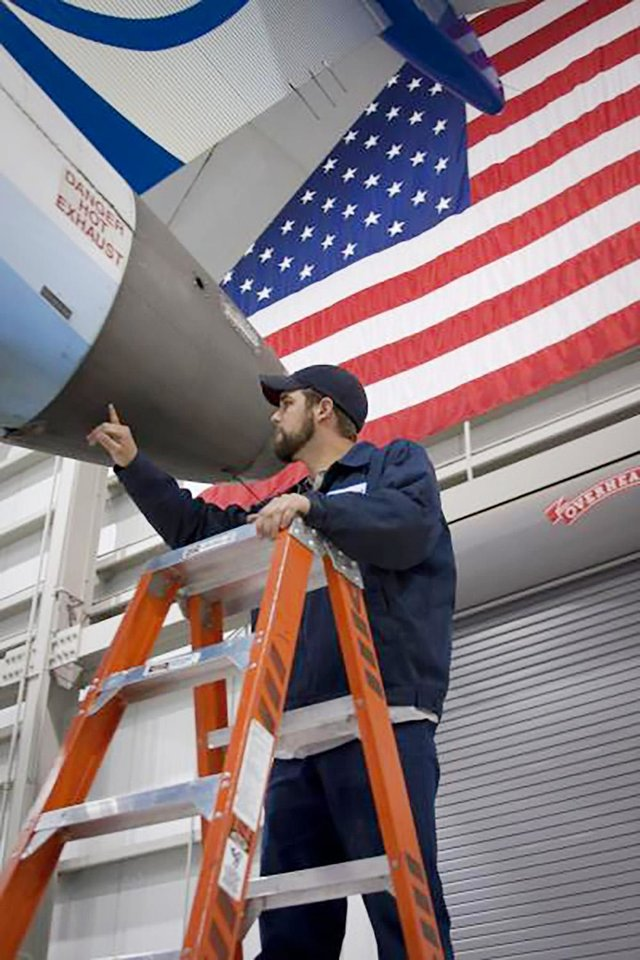 Photo -  A mechanic works on a SkyWest aircraft at one of its maintenance centers. [Photo provided by SkyWest]